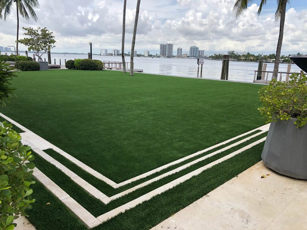 beach side with artificial turf in West Palm Beach